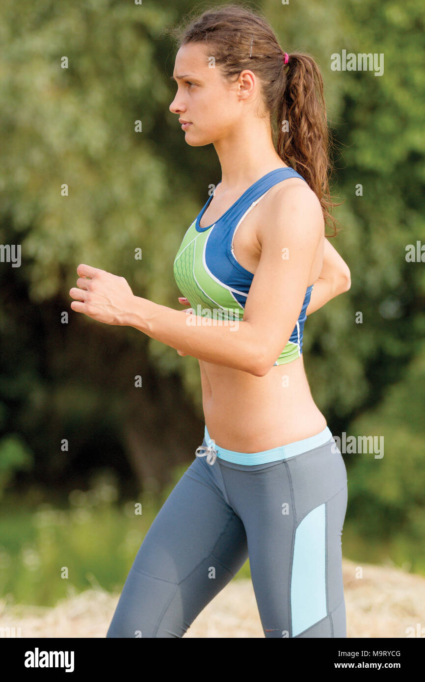 young woman run marathon and recreating fitness sport - Stock Image