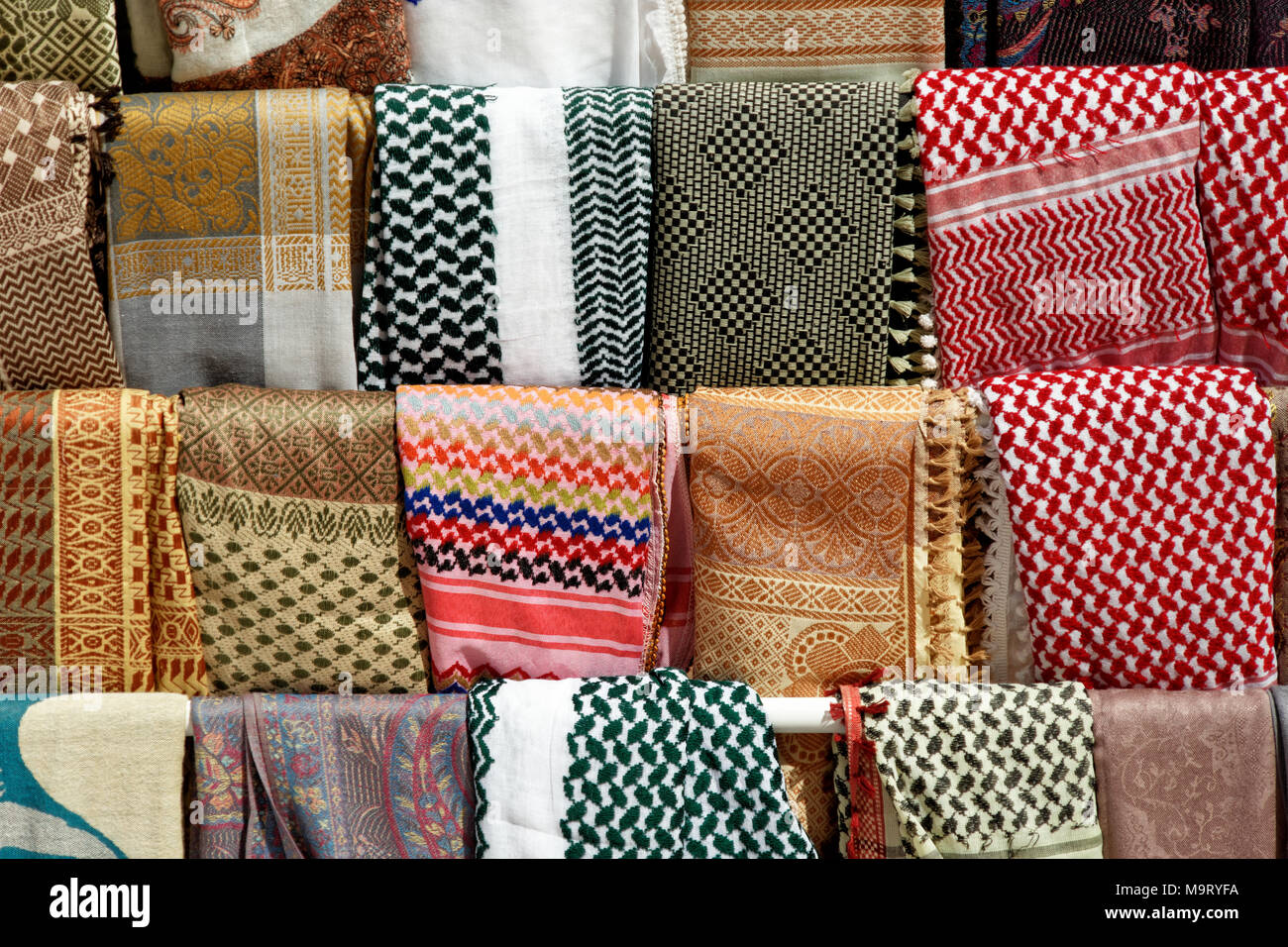 Shawls, scarves and sheets of the Bedouins and Palestinians in Petra, Wadi Musa, Jordan, middle east - Stock Image