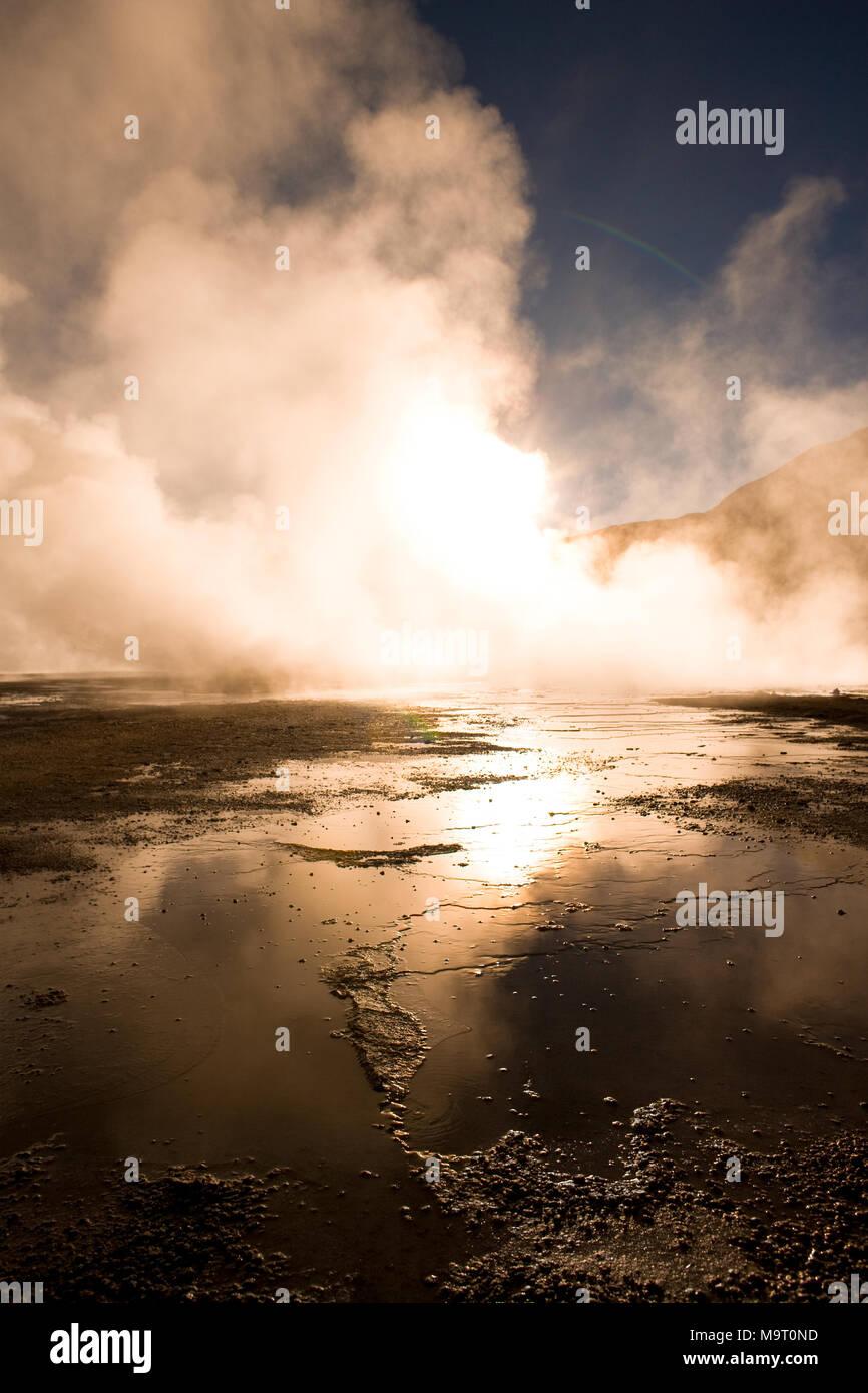 Sunrise behind fumaroles at an altitude of 4300m, El Tatio Geysers, Atacama desert, Antofagasta Region, Chile, South America - Stock Image