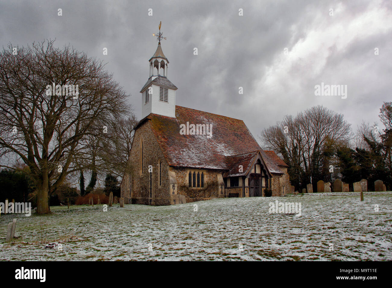 Saint Simon and Saint Jude church at Quendon, near Saffron Walden, on a snowy winter day - Stock Image