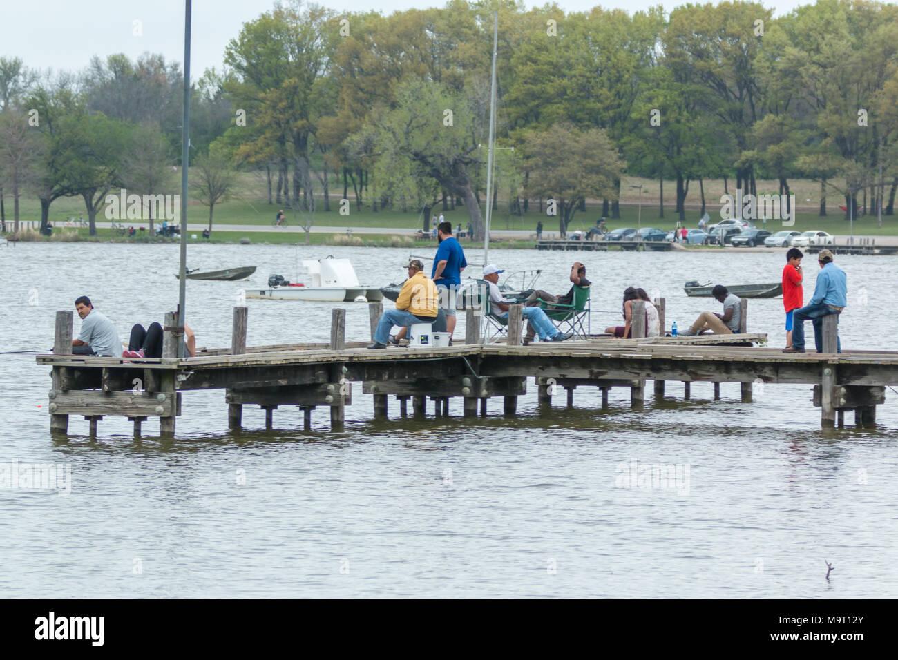 Fishing on pier at White Rock Lake in Dallas Texas Stock