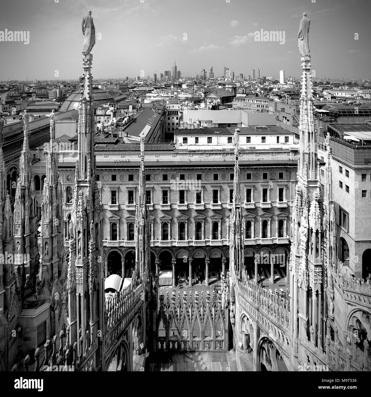 Milan, Lombardy / Italy - 2012/07/04: Roof architecture of the Cathedral of St. Mary Nascente - Duomo Santa Maria Nascente di Milano at Piazza del Duo - Stock Image