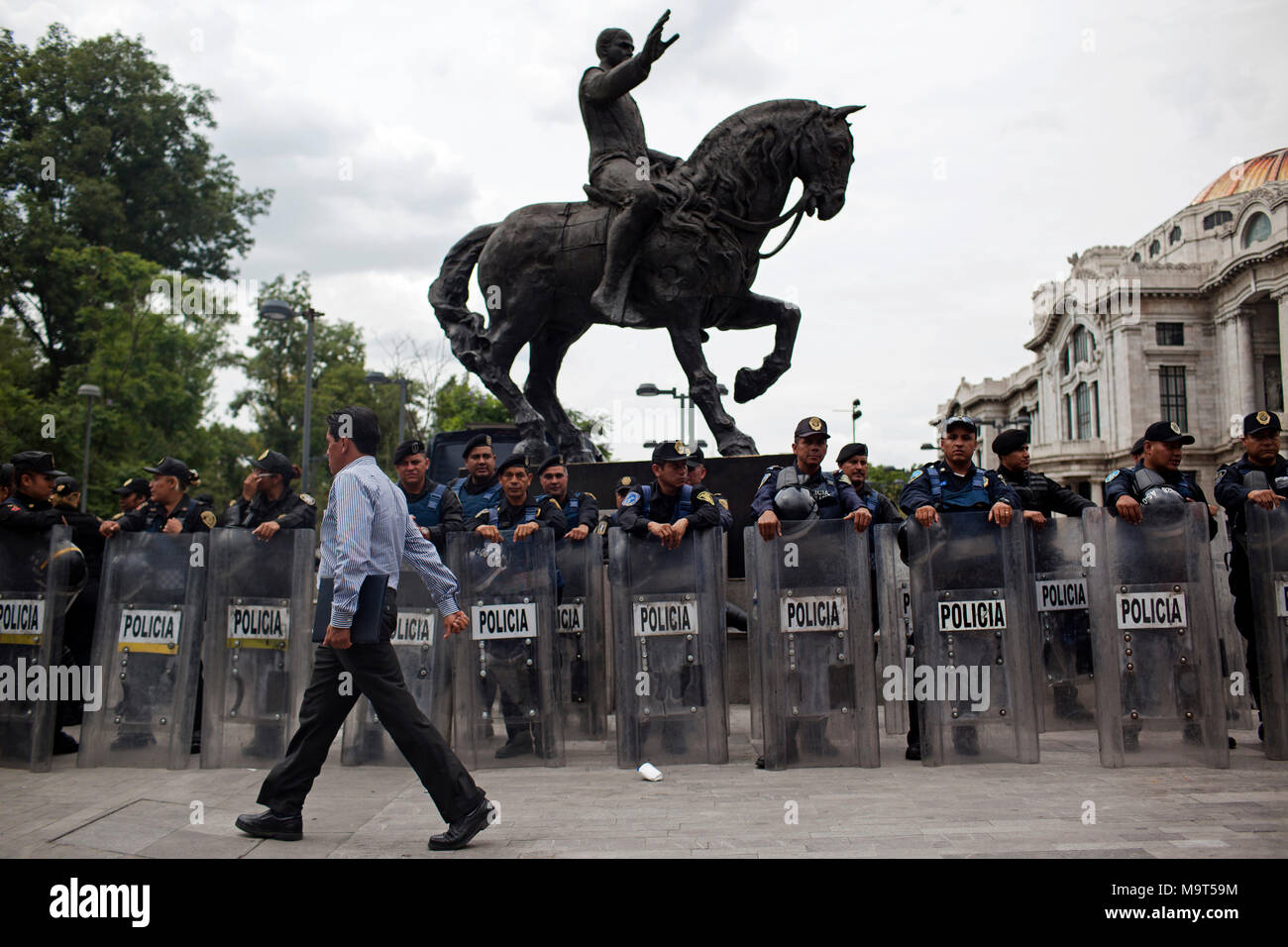A man walks by a line of Mexican Police prior to a protest in Mexico City, Mexico on Monday, June 1, 2015. Numerous protests have occurred prior to Mexico's midterm elections. - Stock Image