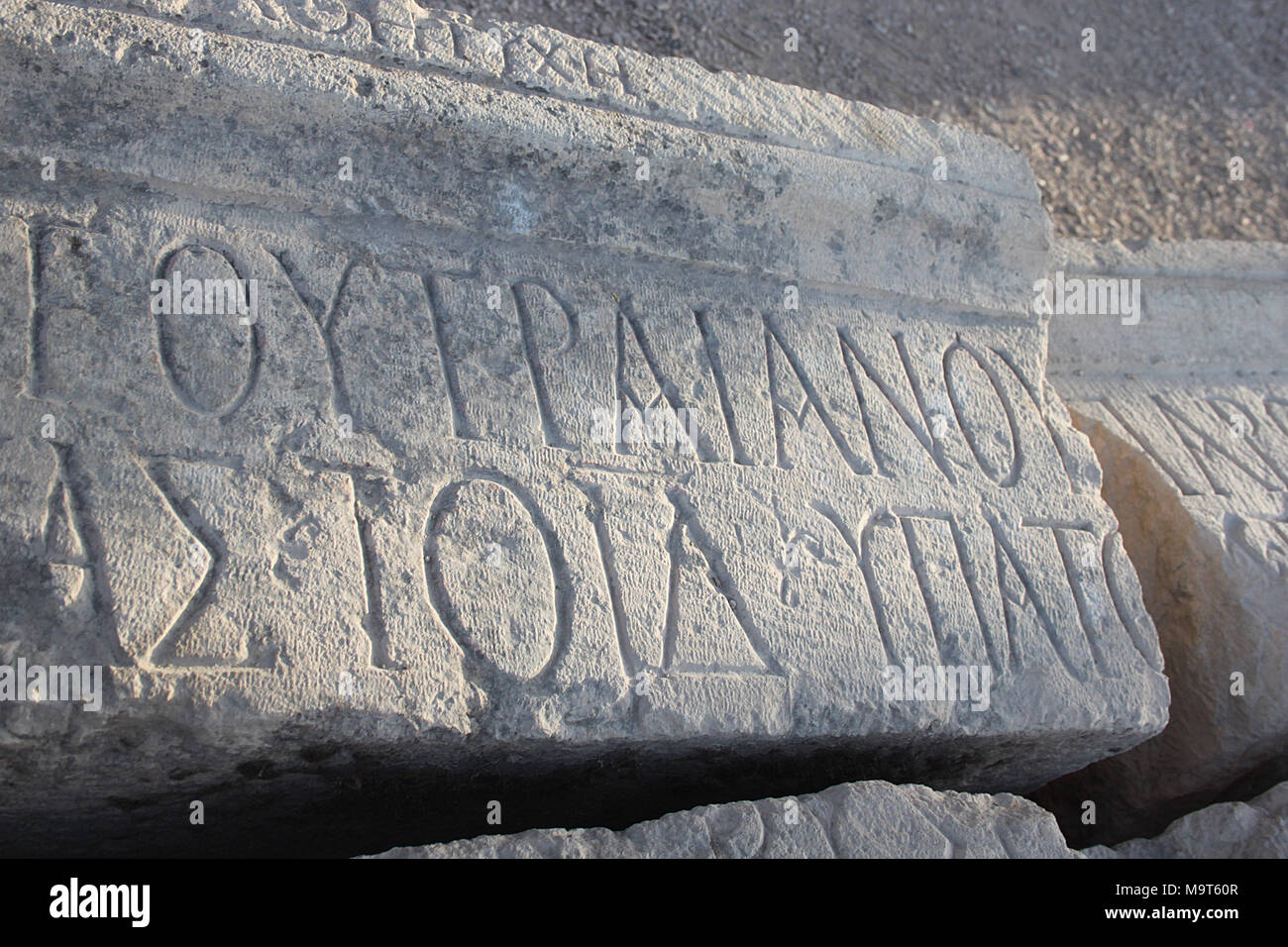 Inscription in the Greek alphabet at Jerash including Emperor Trajan's name. Trajan expanded the city's importance in AD106 by increasing its trade. - Stock Image