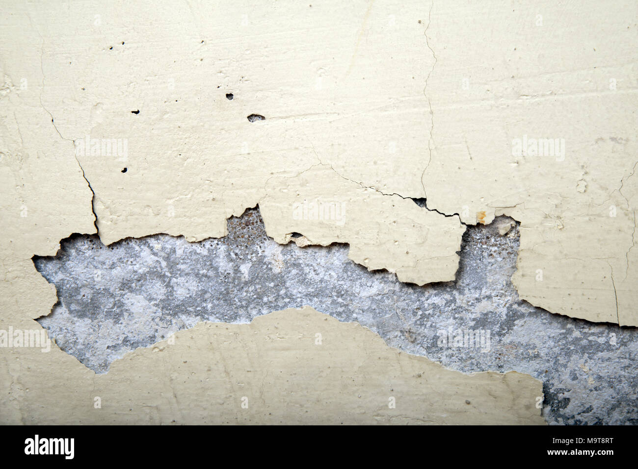 paint cracks on an ancient wall - Stock Image