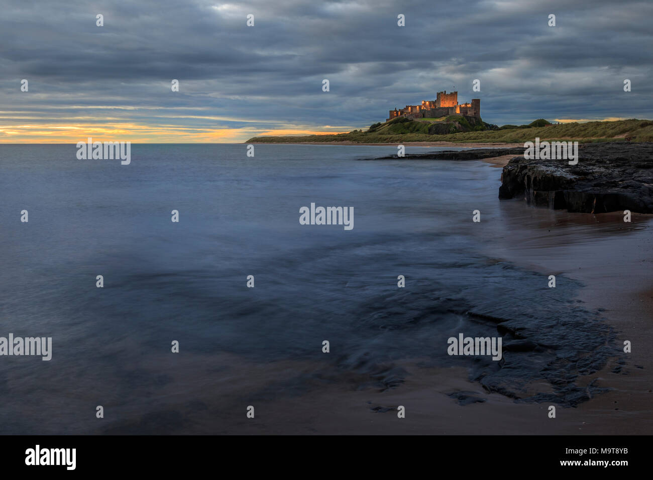 Bamburgh castle sunrise on the Northumberland coastline - Stock Image