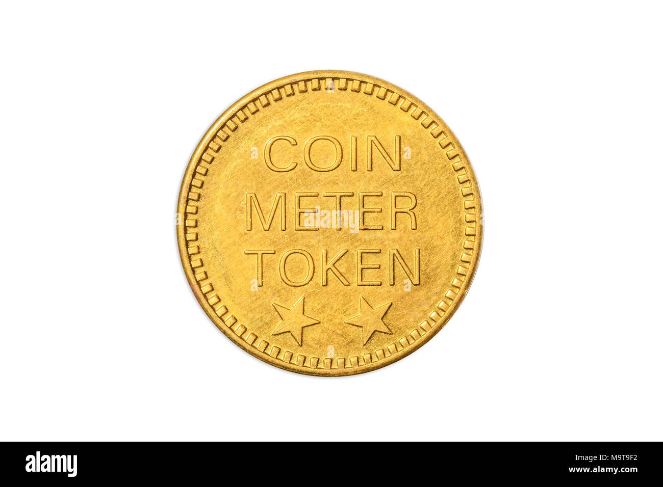 American golden coin meter token with the side of gold stars of America, close up of the tail side with the two stars. Isolated on white studio background. - Stock Image