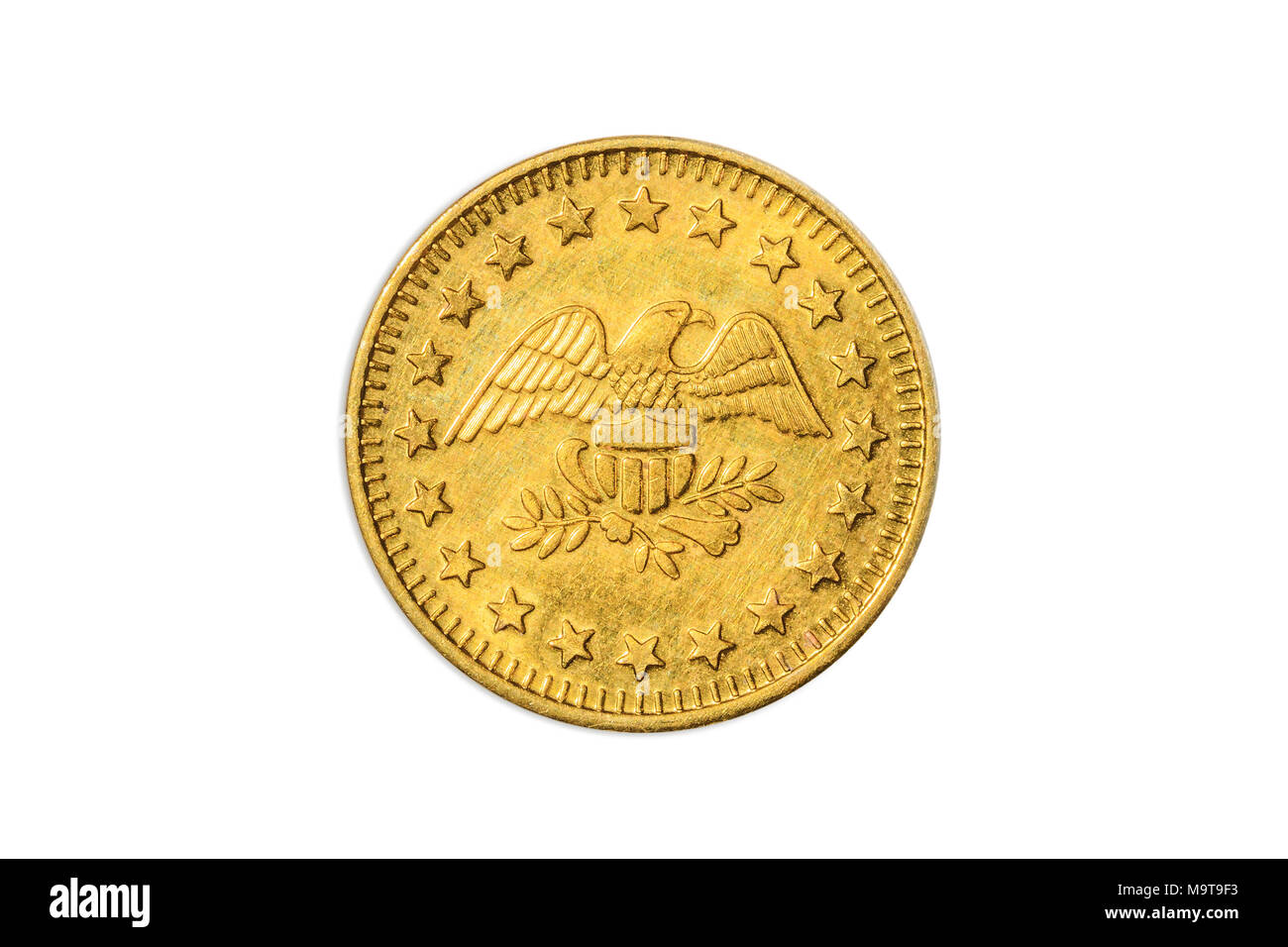 American golden coin meter token with eagle and stars of America, close up of the tail side with the American eagle. Isolated on white studio background. - Stock Image