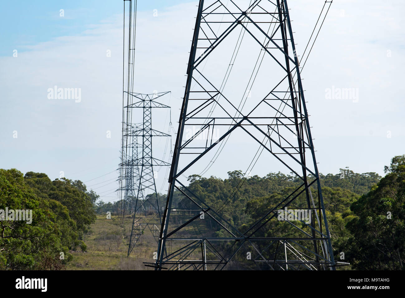 High tension and high voltage power poles and lines in NSW, Australia - Stock Image