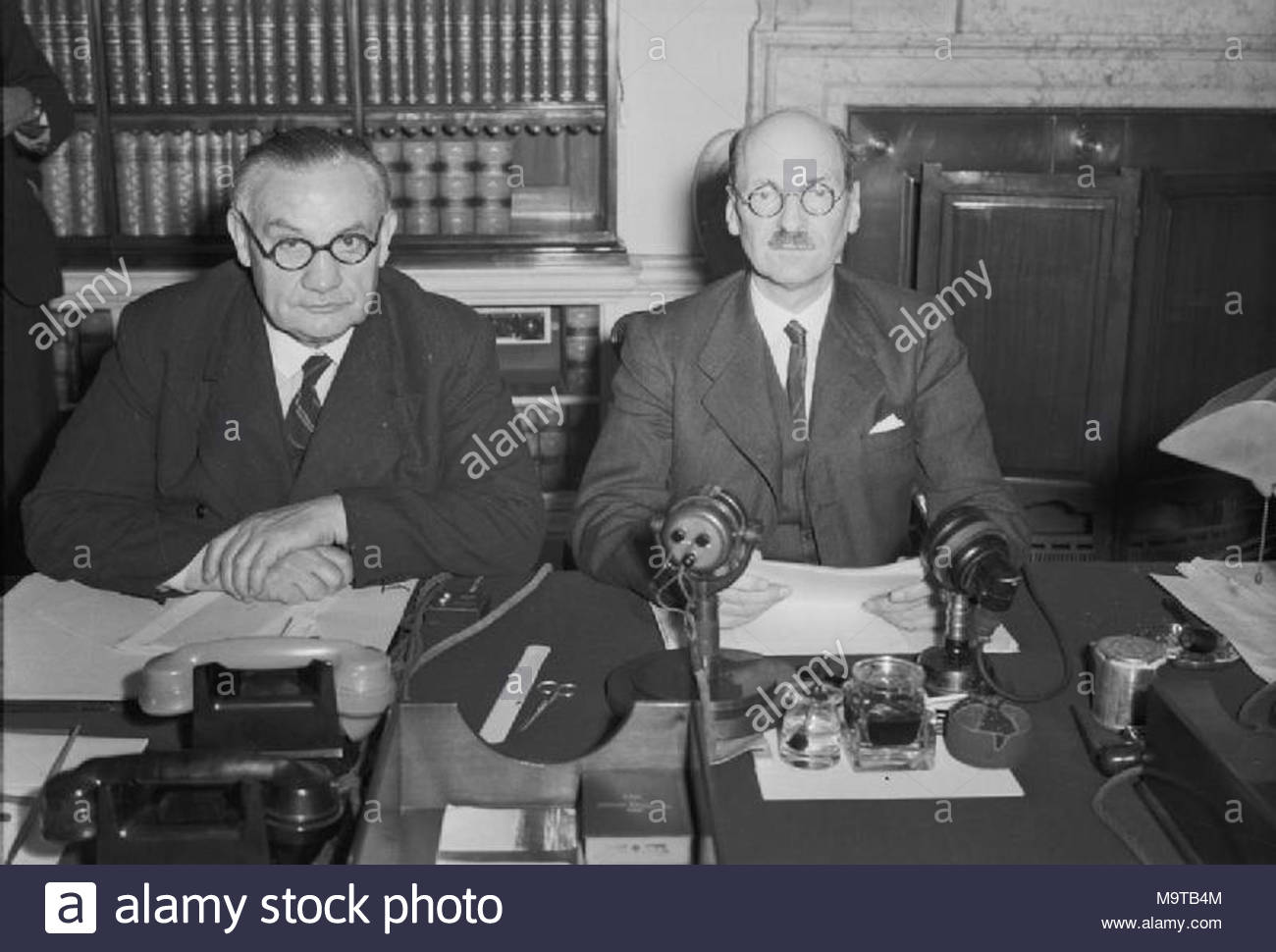 . Prime Minister Clement Attlee (right) and Foreign Secretary Ernest Bevin photographed at 10 Downing Street at midnight on 14 August 1945. They had just announced, in a speech broadcast to Britain and the Empire, the news of the Japanese surrender. - Stock Image