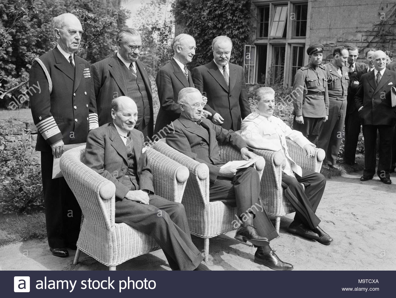 Britain's new Prime Minister, Clement Attlee, with President Truman and Marshal Stalin at the Potsdam Conference in Berlin, 1 August 1945. Clement Attlee with President Truman of the United States and Marshal Stalin of the Soviet Union at the Potsdam Conference in Berlin, shortly after winning the British General election in 1945. Standing from left to right are Admiral Leahy, Ernest Bevin, James Byrnes and Vyacheslav Molotov. The last of the war-time summit conferences was held at Potsdam, outside Berlin from 16 July to 2 August 1945 and the results of the British General Election were announ - Stock Image