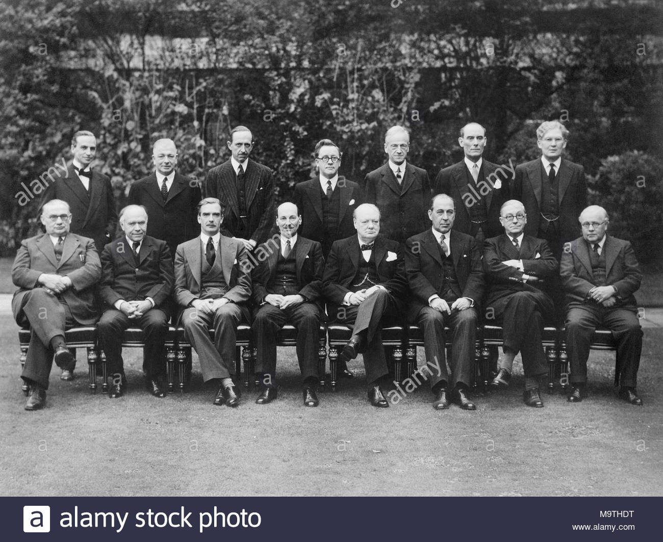 British Political Personalities 1936-1945 The Churchill Coalition Government 11 May 1940 - 23 May 1945: The Churchill Coalition War Cabinet: standing, from left to right, Sir Archibald Sinclair, Mr A V Alexander, Lord Cranborne, Herbert Morrison, Lord Moyne, Captain Margesson and Brendan Bracken. Seated, from left to right, Ernest Bevin, Lord Beaverbrook, Anthony Eden, Clement Attlee, Winston Churchill, Sir John Anderson, Arthur Greenwood and Sir Kingsley Wood. - Stock Image