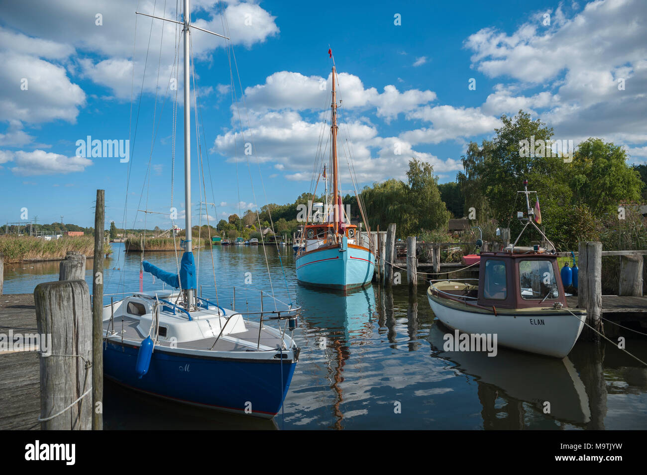 Fishing boats in natural harbor of the fishing village Gothmund at the river Trave, Gothmund, Baltic Sea, Schleswig-Holstein, Germany, Europe - Stock Image
