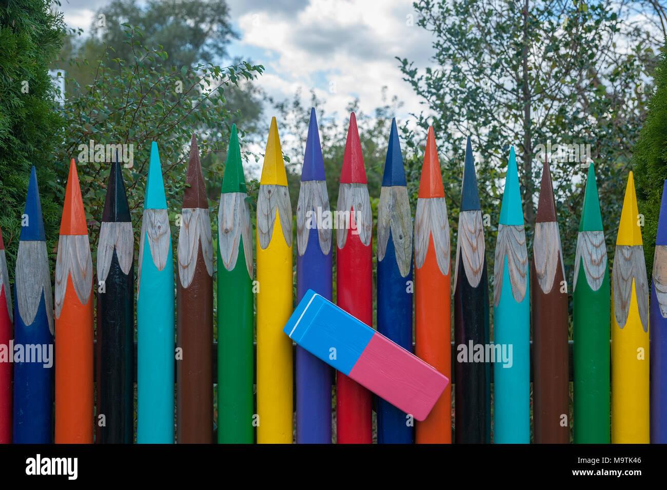 Colored pencils as garden fence in the fishing village Gothmund, Lubeck Gothmund, Baltic Sea, Schleswig-Holstein, Germany, Europe - Stock Image