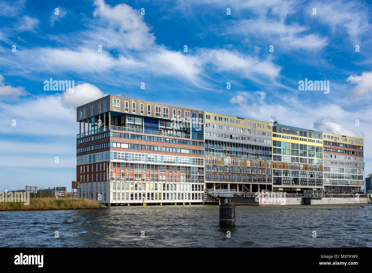 Unique modern design apartment building on the waterside 't IJ in Amsterdam the Netherlands. - Stock Image