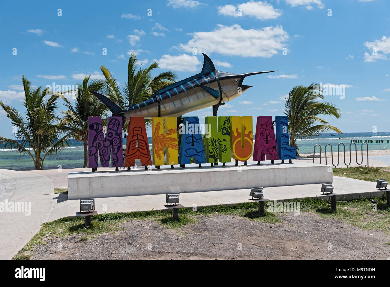 Colored lettering of tourist resort Mahahual with marlin fish - Stock Image