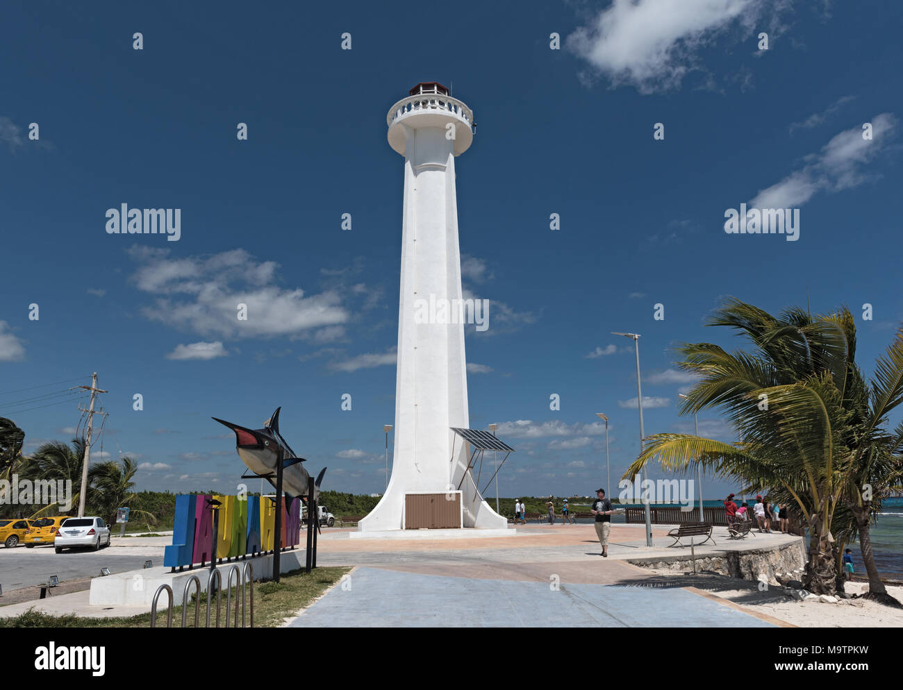 Lighthouse with colored lettering of tourist resort Mahahual with marlin fish, Mexico - Stock Image