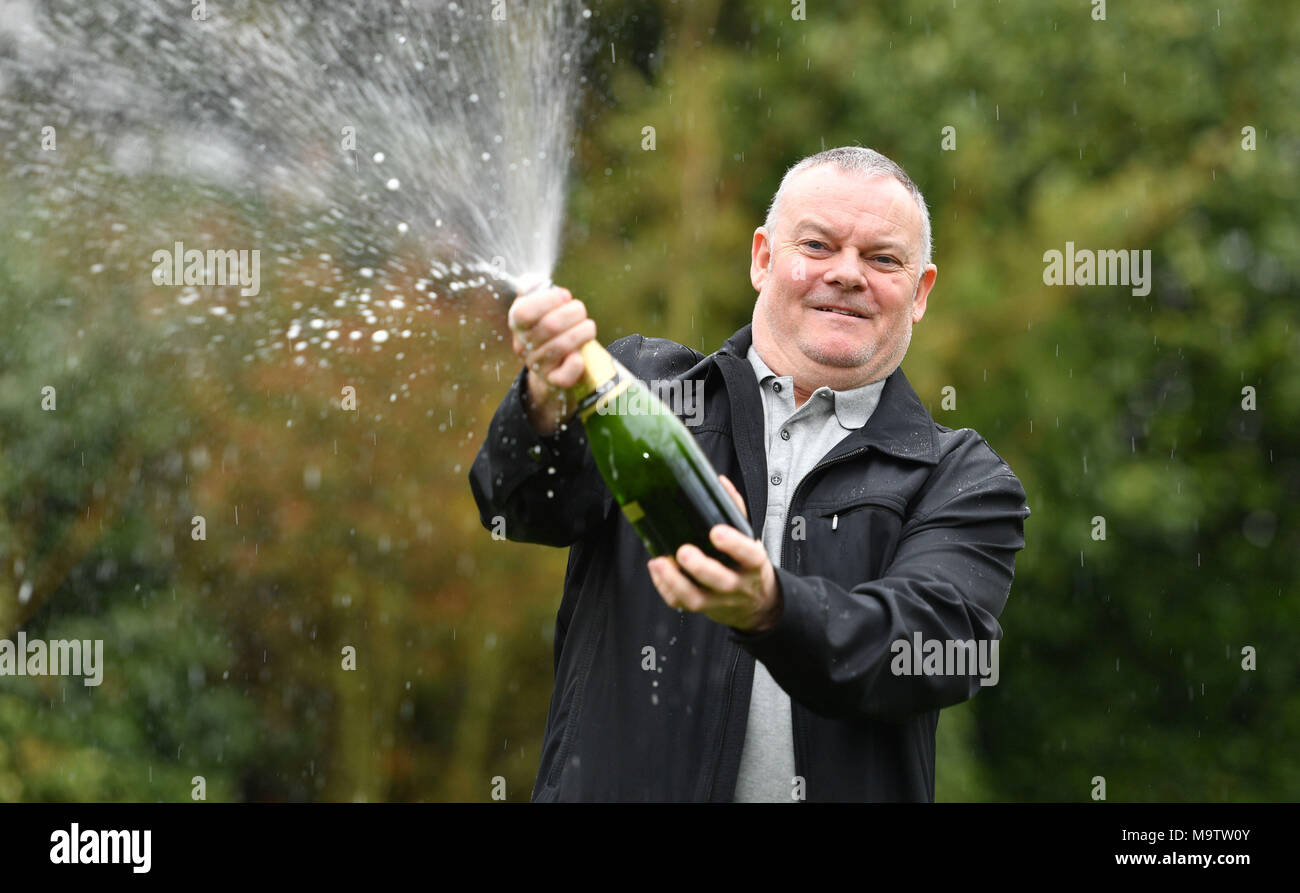 Father of three and life-long Leyton Orient fan from Wickford, Paul Long, celebrates after his Lucky Dip ticket matched all six numbers to scoop the £9,339,858 Lotto Jackpot on Saturday 24 March, at the Orsett Hall Hotel, in Orsett, Essex. Stock Photo