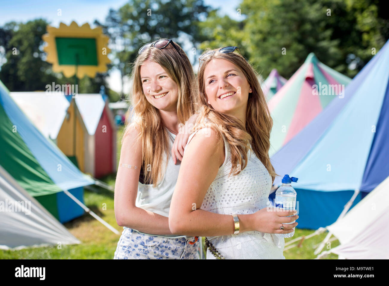 Girls in a 'Glamping' area at the Cornbury Music Festival UK - Stock Image