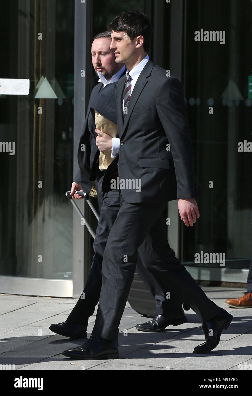 Blane McIlroy (right) leaving Belfast Crown Court after being found not guilty of exposure. - Stock Image