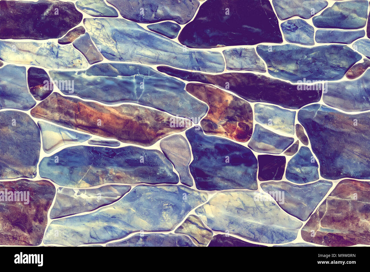 Stone wall rustic texture big seamless background. infinitely seamless texture of dark blue and brown marble stones for decoration of walls and fences - Stock Image