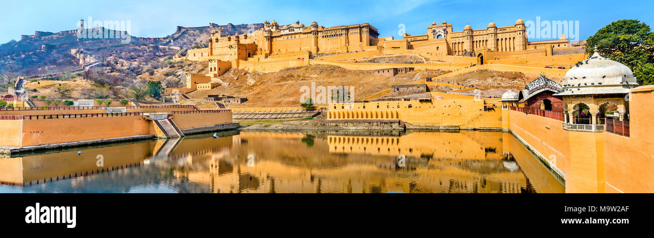 Amer and Jaigarh Forts and Kesar Kyari Garden in Maotha Lake. Jaipur - Rajasthan State of India - Stock Image