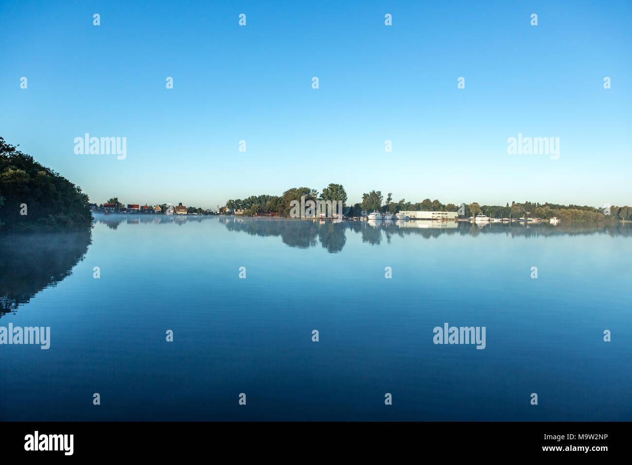 Reflection of a harbour in te water over the citylake 'the Nieuwe Meer' in Amsterdam the Netherlands. - Stock Image