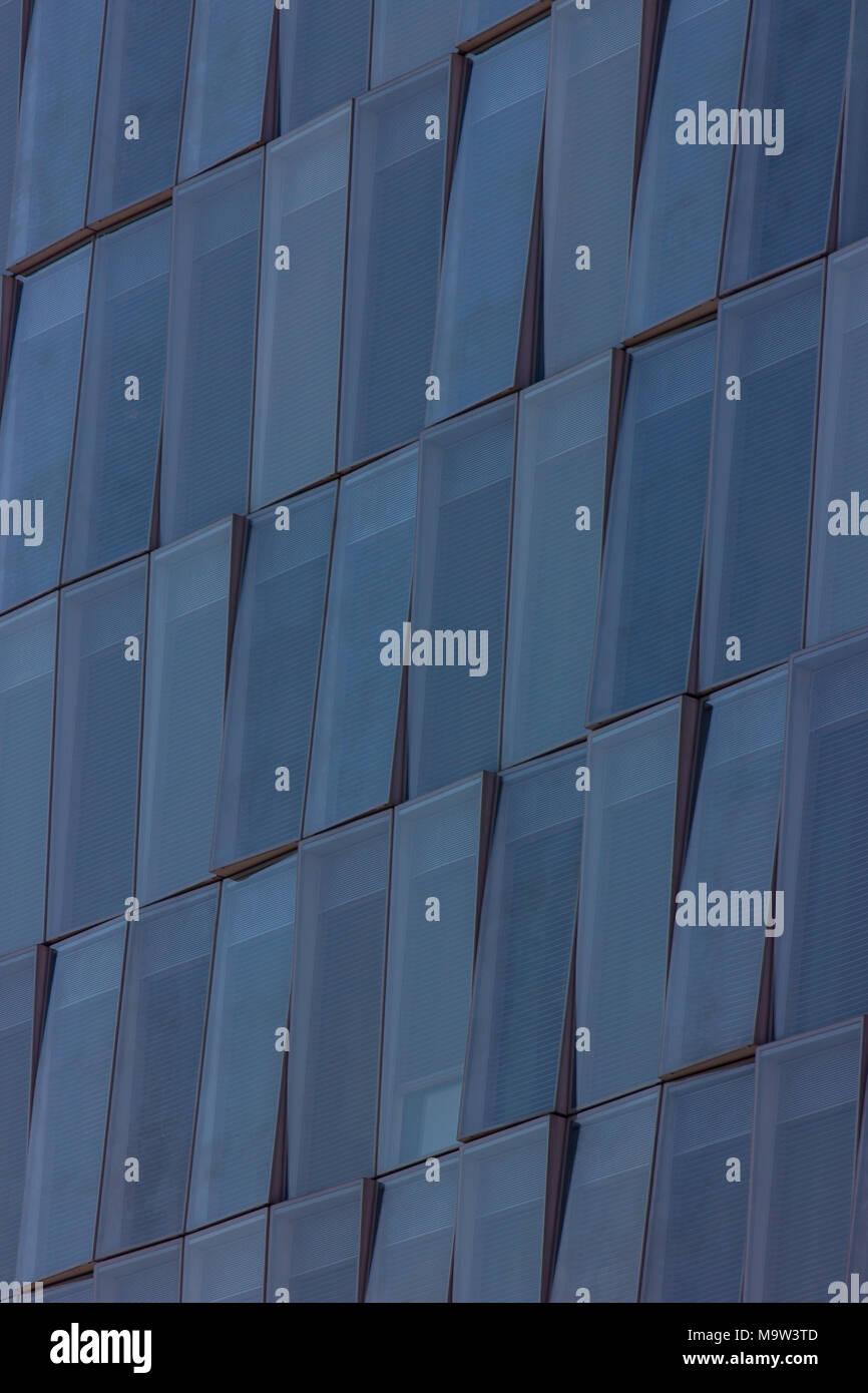 a beautiful detail shot of a modern building, blue windows, Milan, Italy Stock Photo