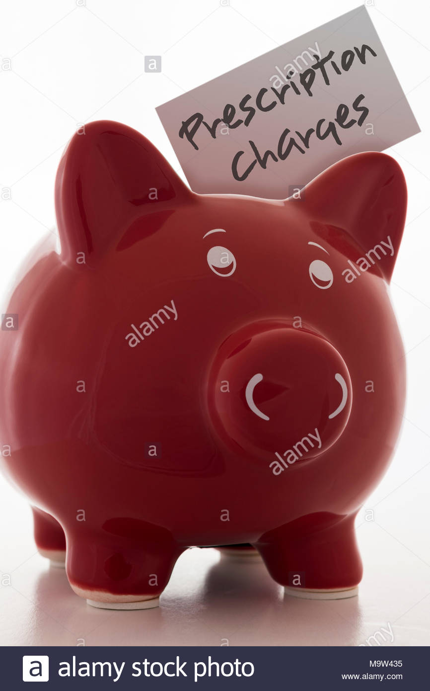 Red Piggy Bank (Money Box) with the label Prescription Charges - Stock Image