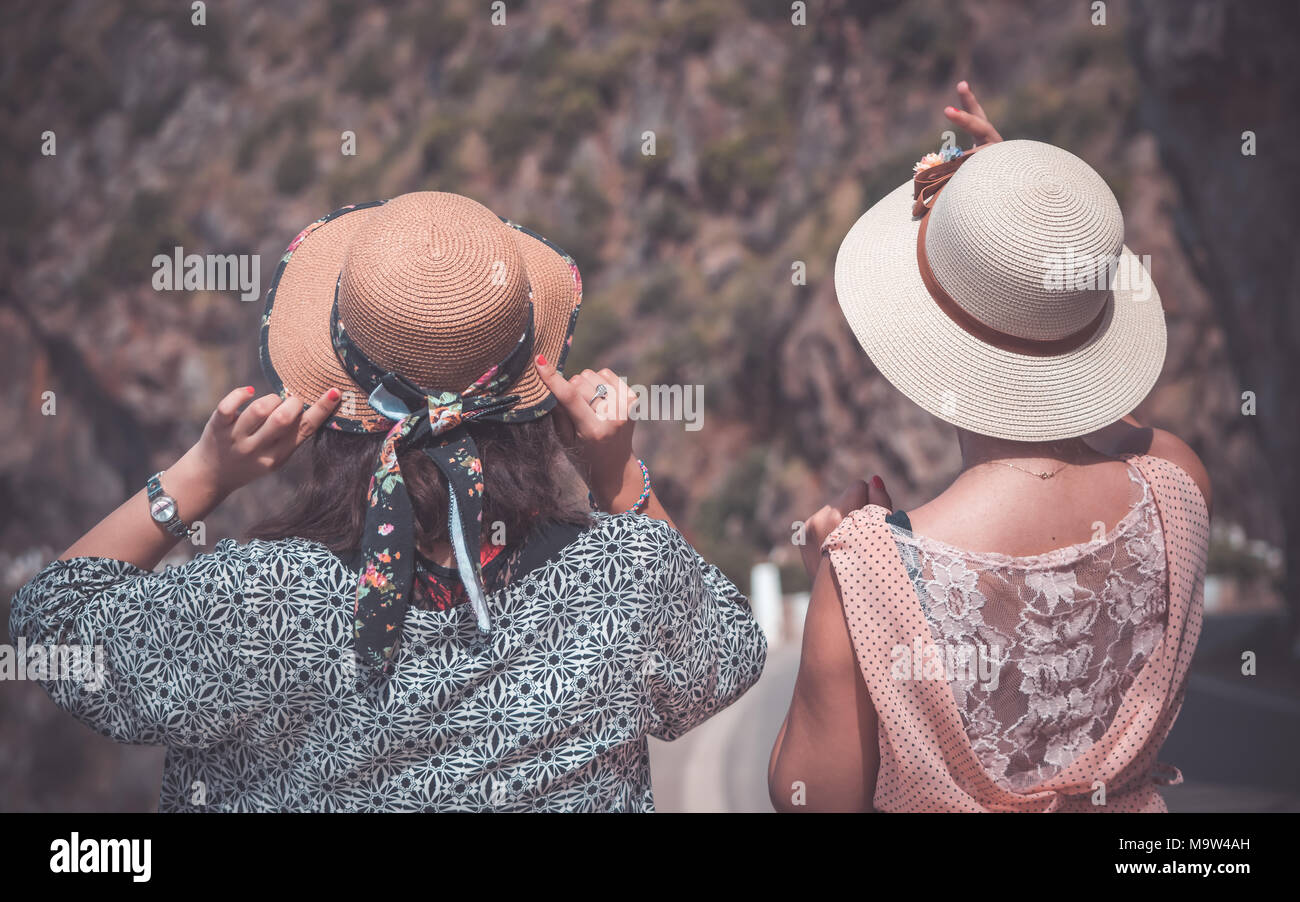 portrait of two wemen wearing hats looking at mountain Stock Photo
