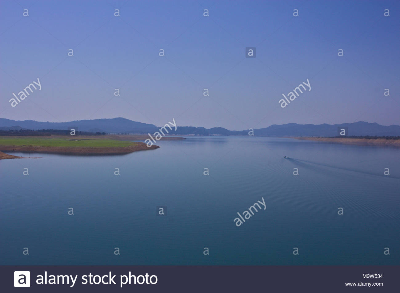 Lake with hills in the background - Stock Image