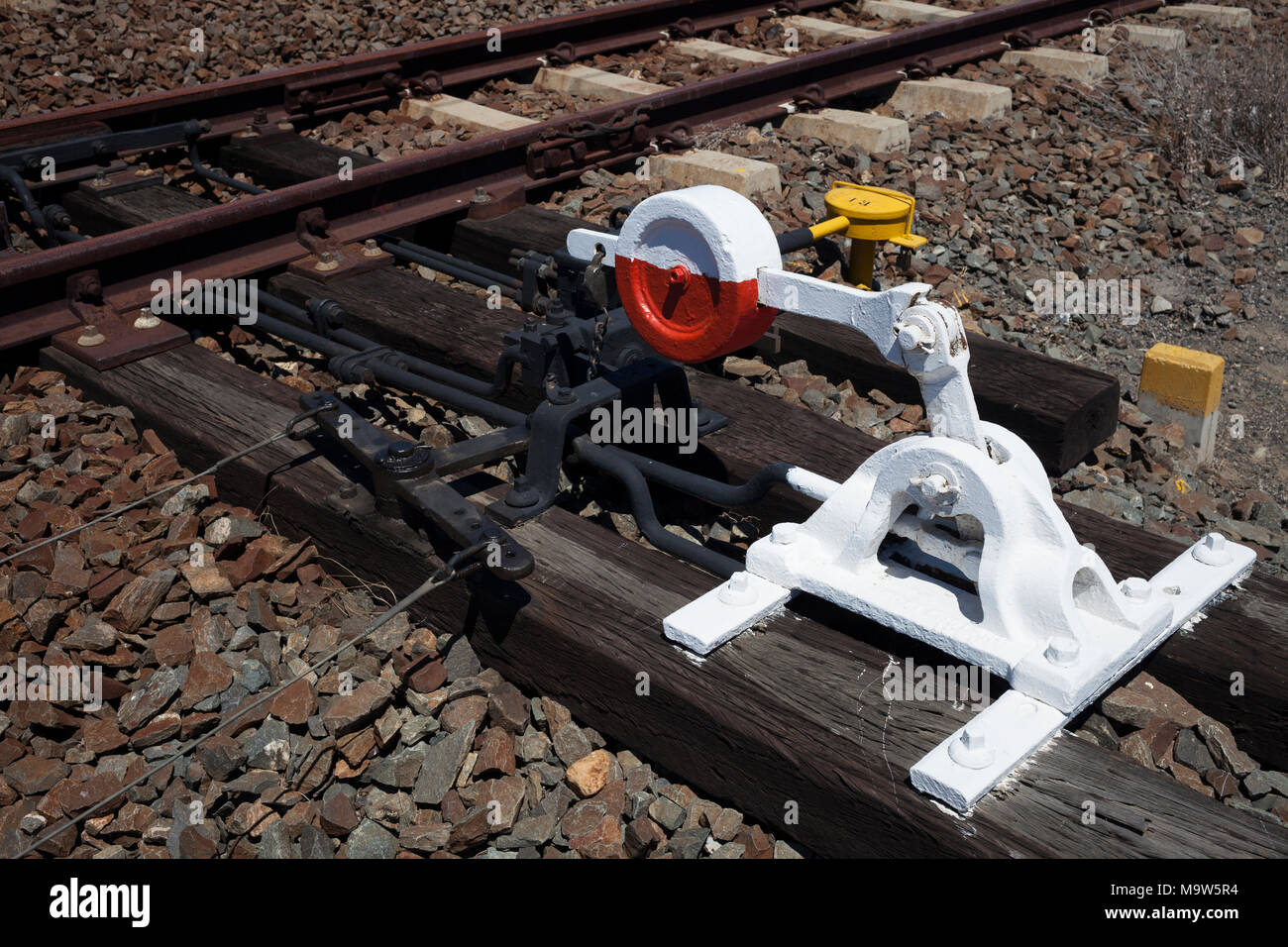 A point lever at a railway switch and track on a railway line in the Western Cape. - Stock Image
