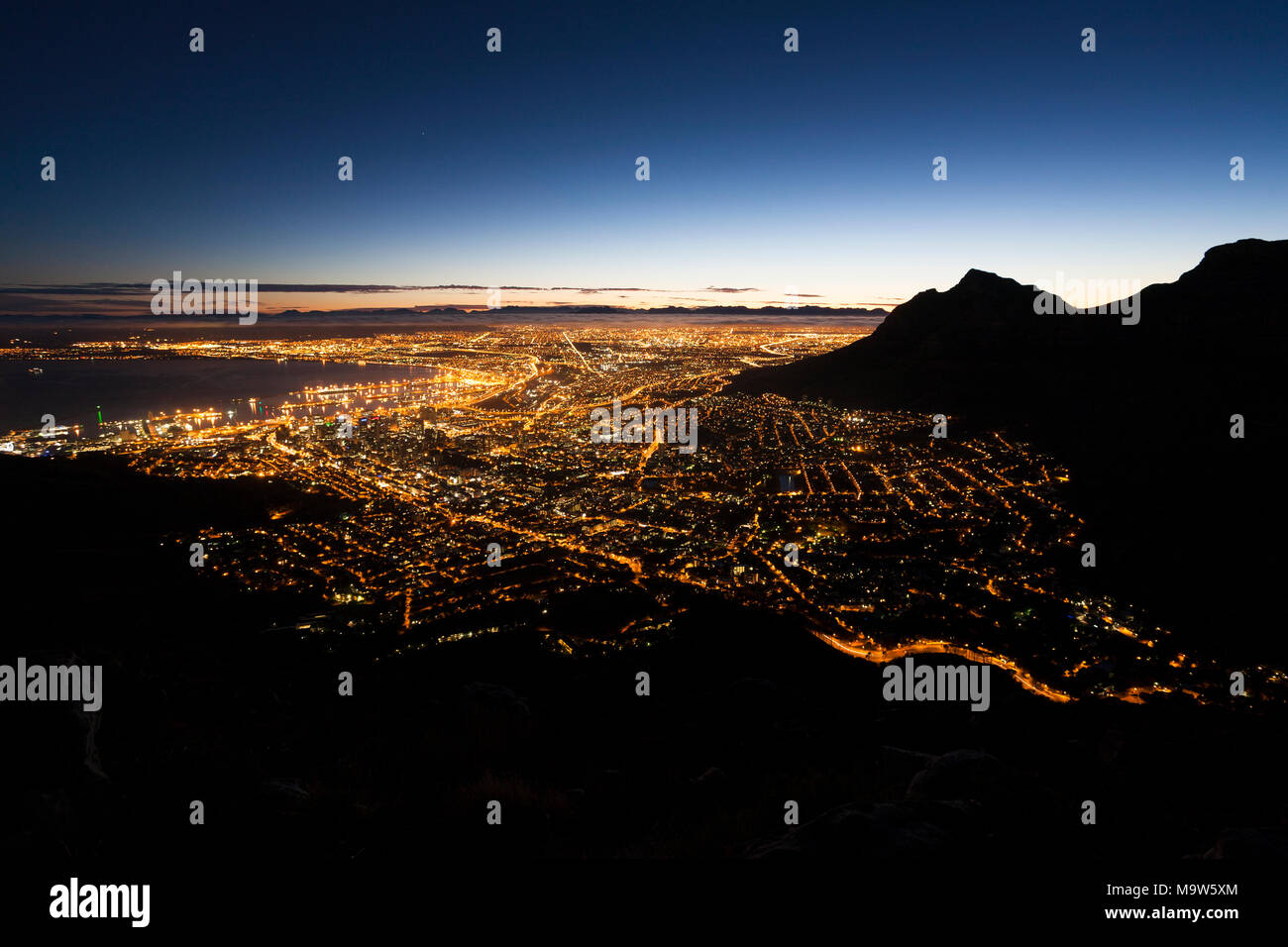 A view at dawn across Cape Town City, Table Bay and Devil's Peak. - Stock Image