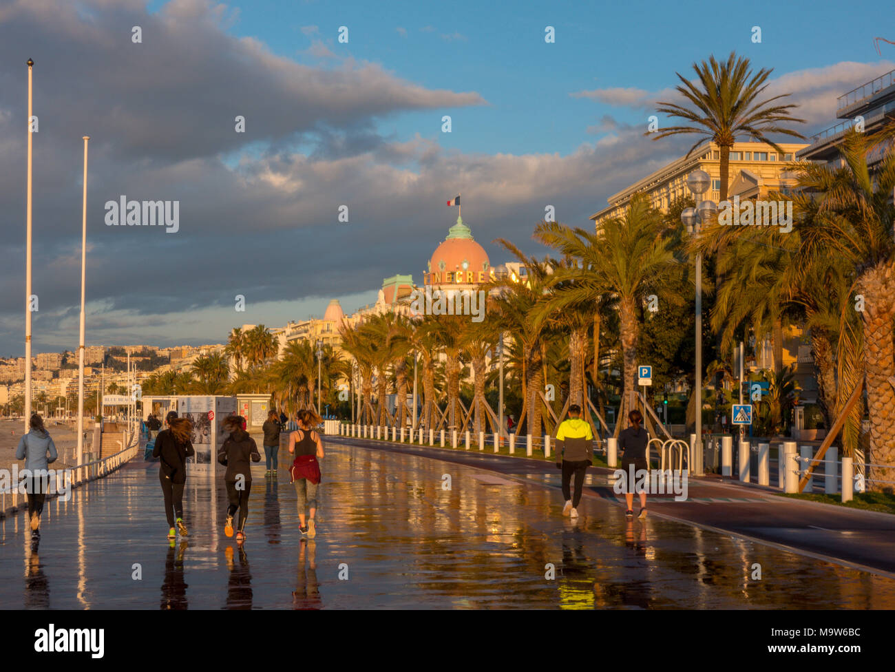 Joggers on Promenade des Anglais in early morning, Nice - Stock Image