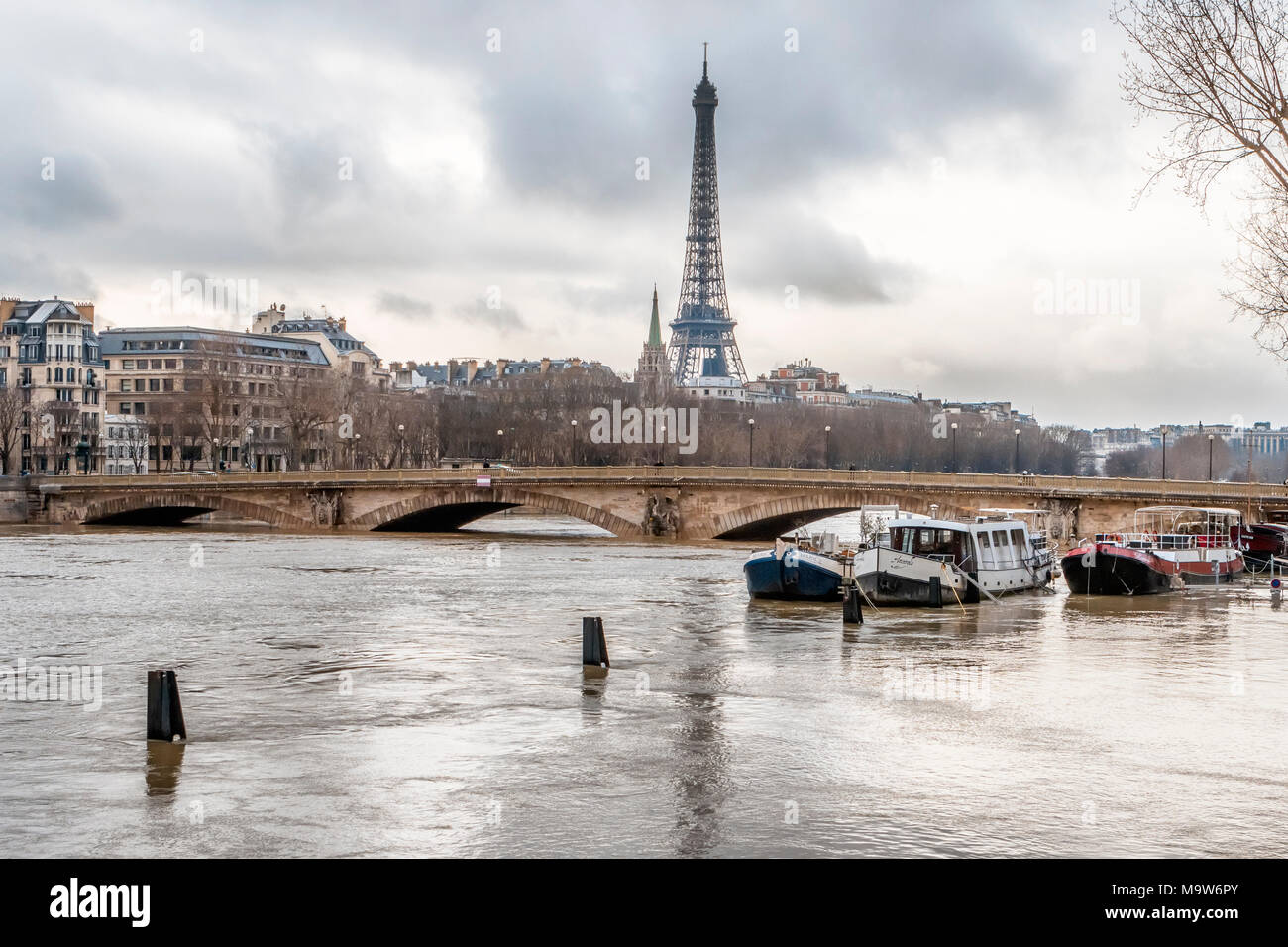 Pont des Invalides submerged in the Paris flood of January 2018 and stranded boats unable to travel on the River Seine due to high water levels - Stock Image