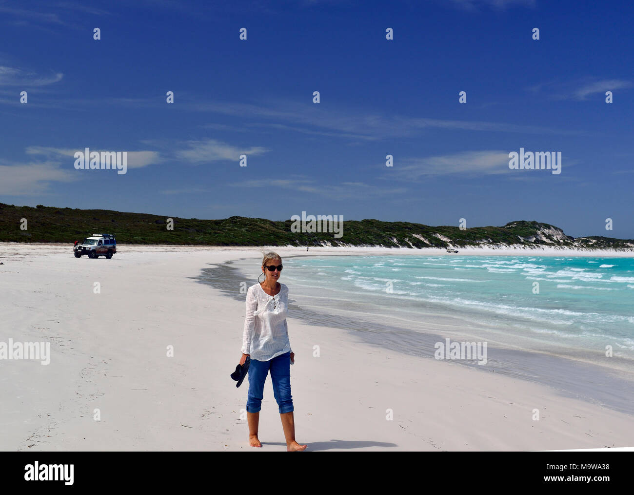 Tourist walk along the stunning white sand of Lucky Bay in the Cape Le Grand National Park, west of Esperance, south coast, Western Australia Stock Photo