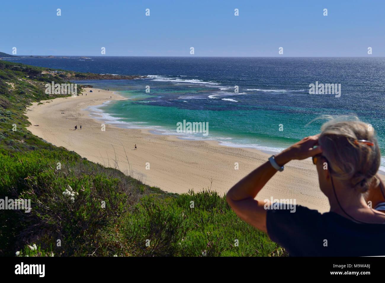 Woman looking south  along  Yallingup beach towards Yallingup.   Yallingup, Western Australia Stock Photo
