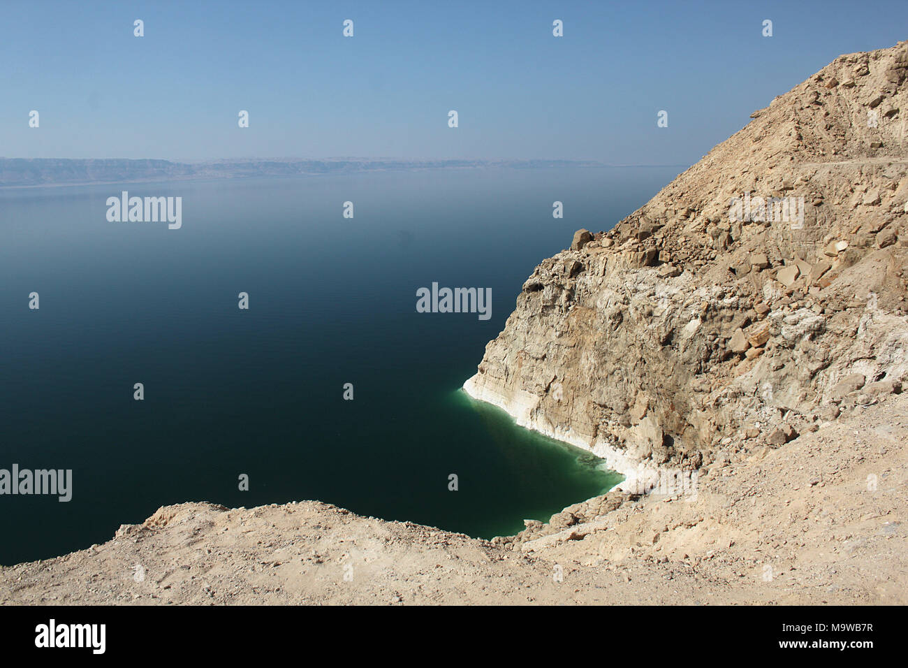 The Dead Sea shore seen from Jordan, with Israel in the distance. At 790 metres below sea level, the valley is one of the lowest land masses on Earth. Stock Photo