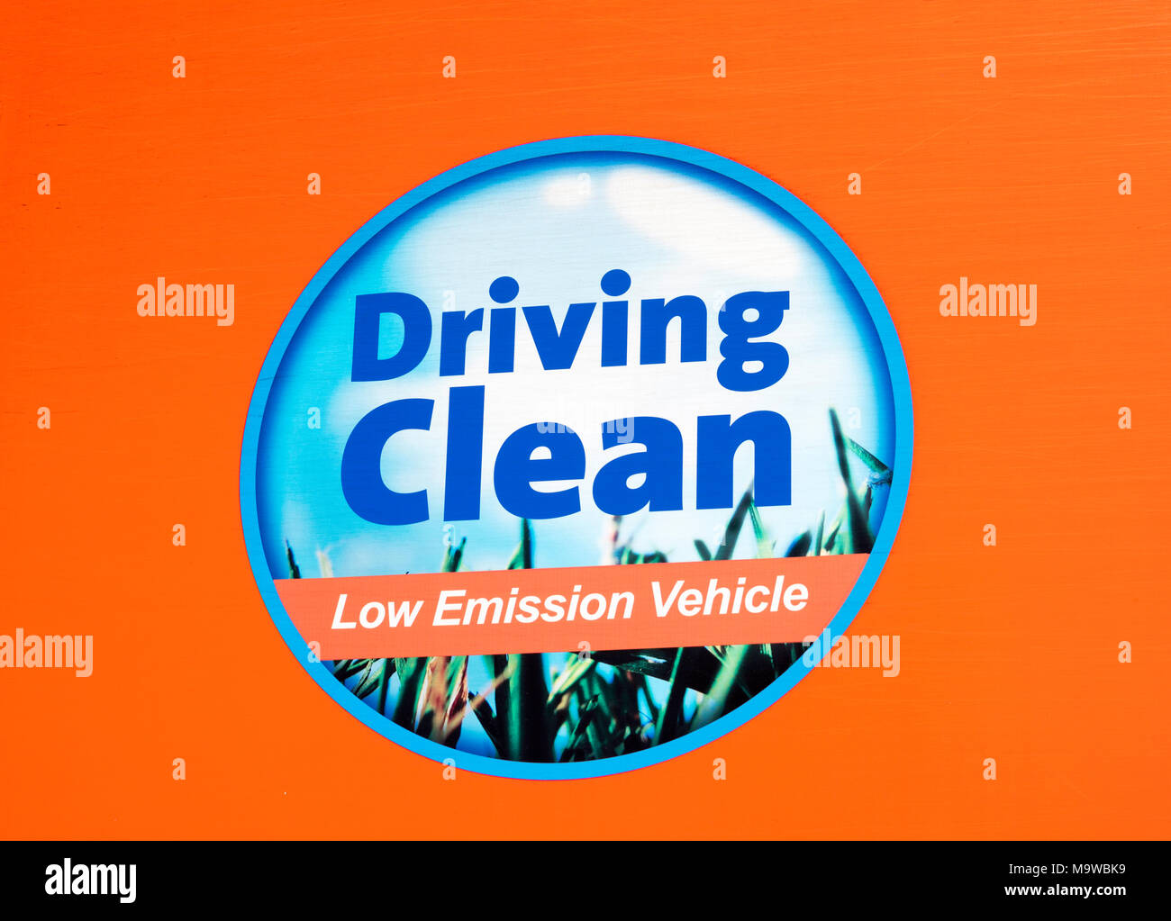 Driving Clean, Low Emission Vehicle motif on the side of a TNT delivery truck, England, UK - Stock Image
