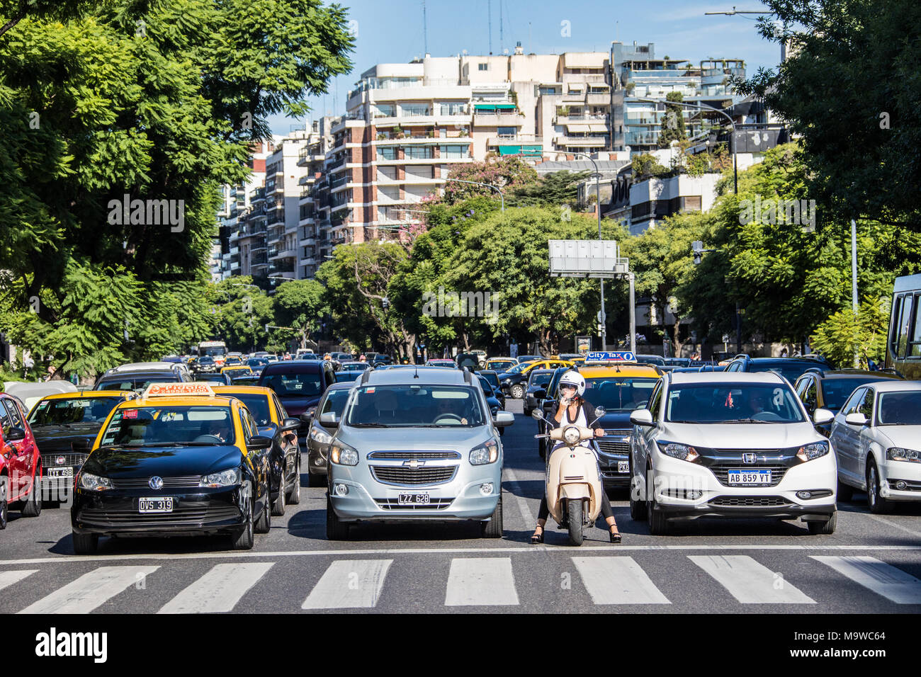 Traffic llined up at a stoplight, Buenos Aires, Argentina - Stock Image
