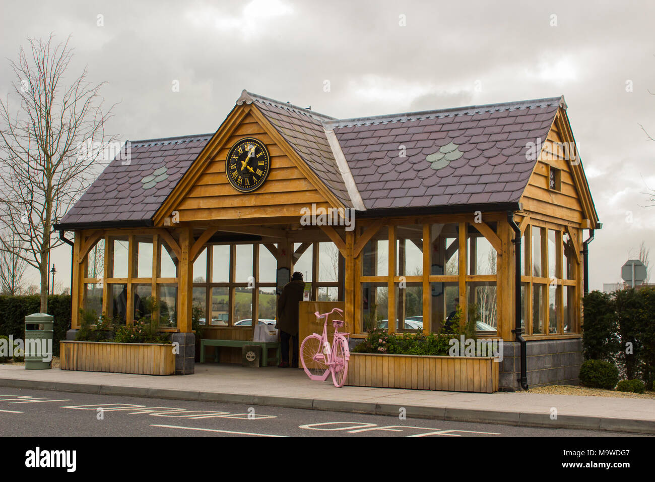 The pick up and drop off point for the free transport service at the prestigious Kildare Village retail outlet in county Kildare Ireland - Stock Image