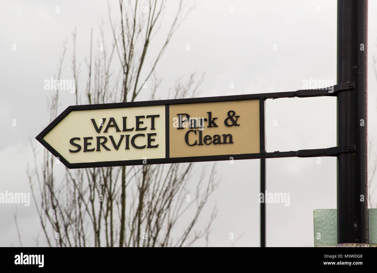 A sign pointing the way to the Valet Service, one of the many businesses at the prestigious Kildare Village retail outlet in county Kildare Ireland - Stock Image