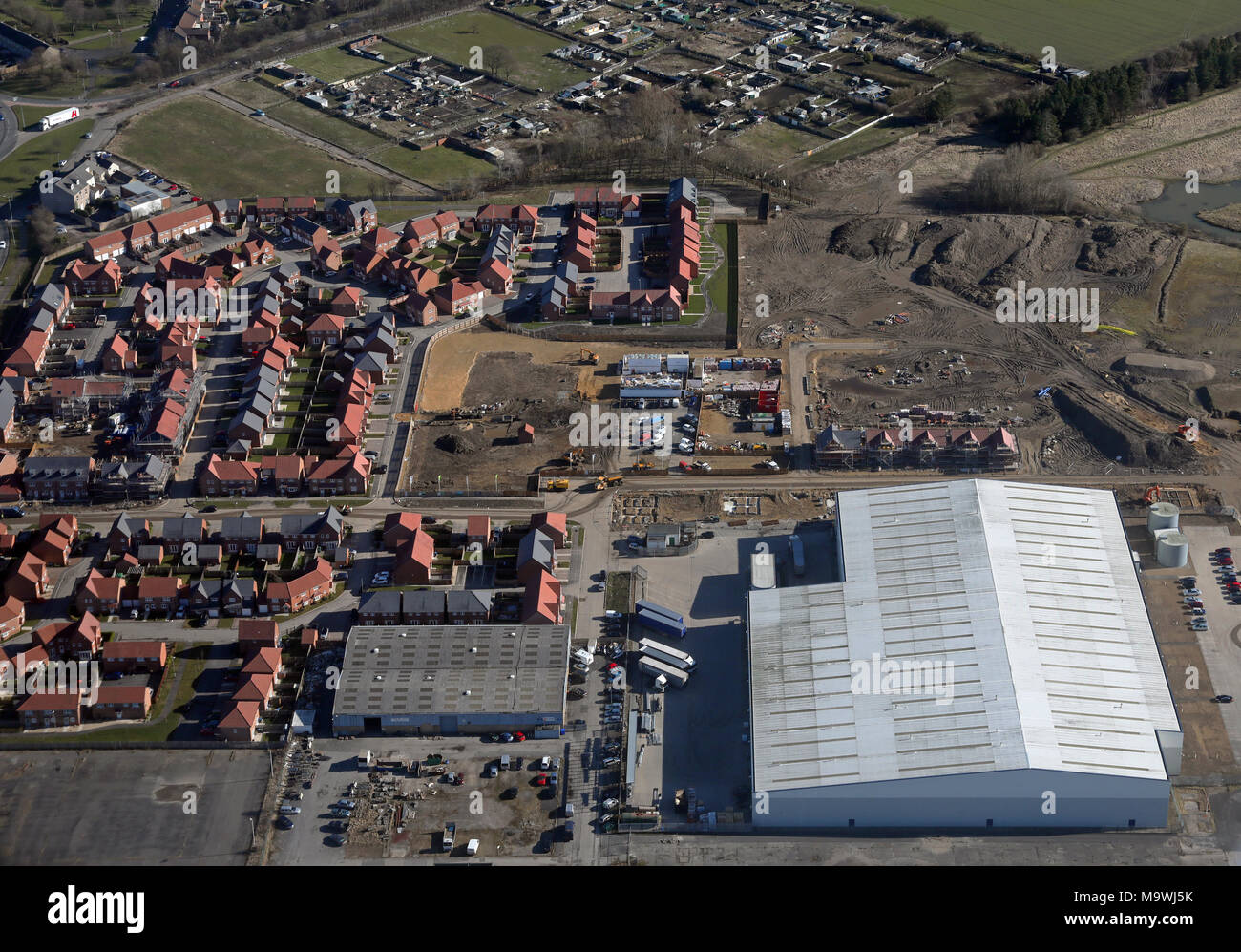 aerial view of new housing and industry - Stock Image