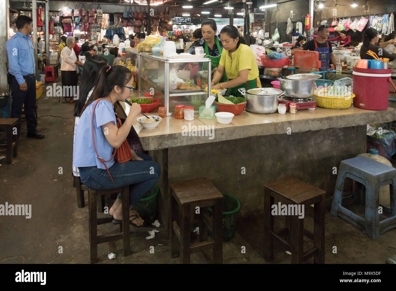 Siem Reap, Cambodia, 28 March 2018  Girls eating at the