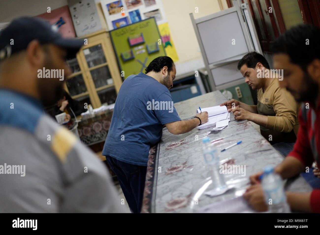(180328) -- CAIRO, March 28, 2018 (Xinhua) -- A man registers at a polling station in Cairo, Egypt, on March 28, 2018. The third and final day of Egypt's 2018 presidential election kicked off on Wednesday at 9 a.m. Cairo local time (0700 GMT) amid calls for citizens to take part in the polls. (Xinhua/Ahmed Gomaa) - Stock Image
