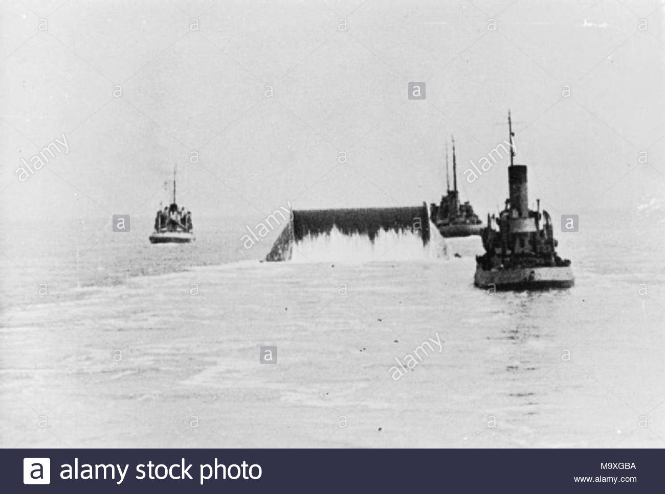 The Battle for Normandy: A 'Conundrum' being towed across the English Channel laying out pipe behind it to form an underwater pipe line from Southampton to Cherbourg which kept the Allied armies supplied with petrol until the Channel ports could be re-activated. Known as Pluto, this was an entirely British conception designed by Captain John Hutchings, Royal Navy. - Stock Image