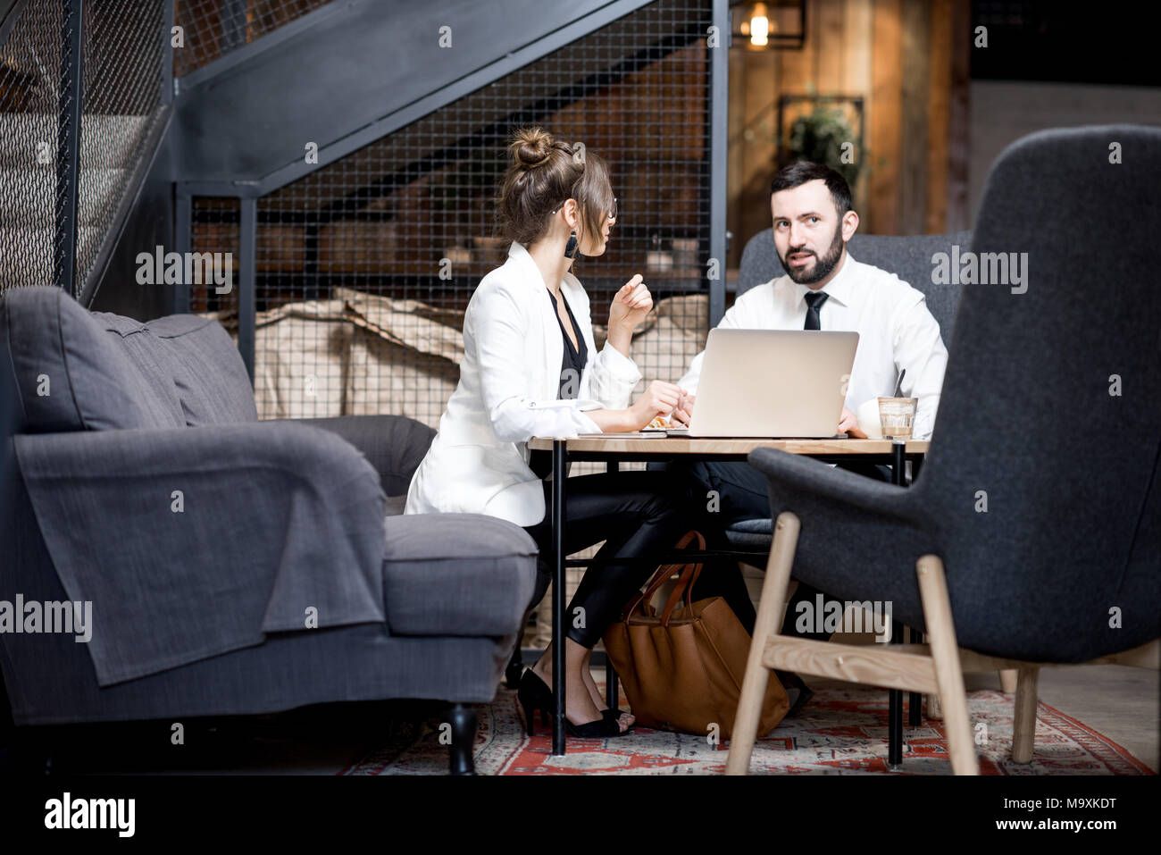 Business couple at the cafe Stock Photo