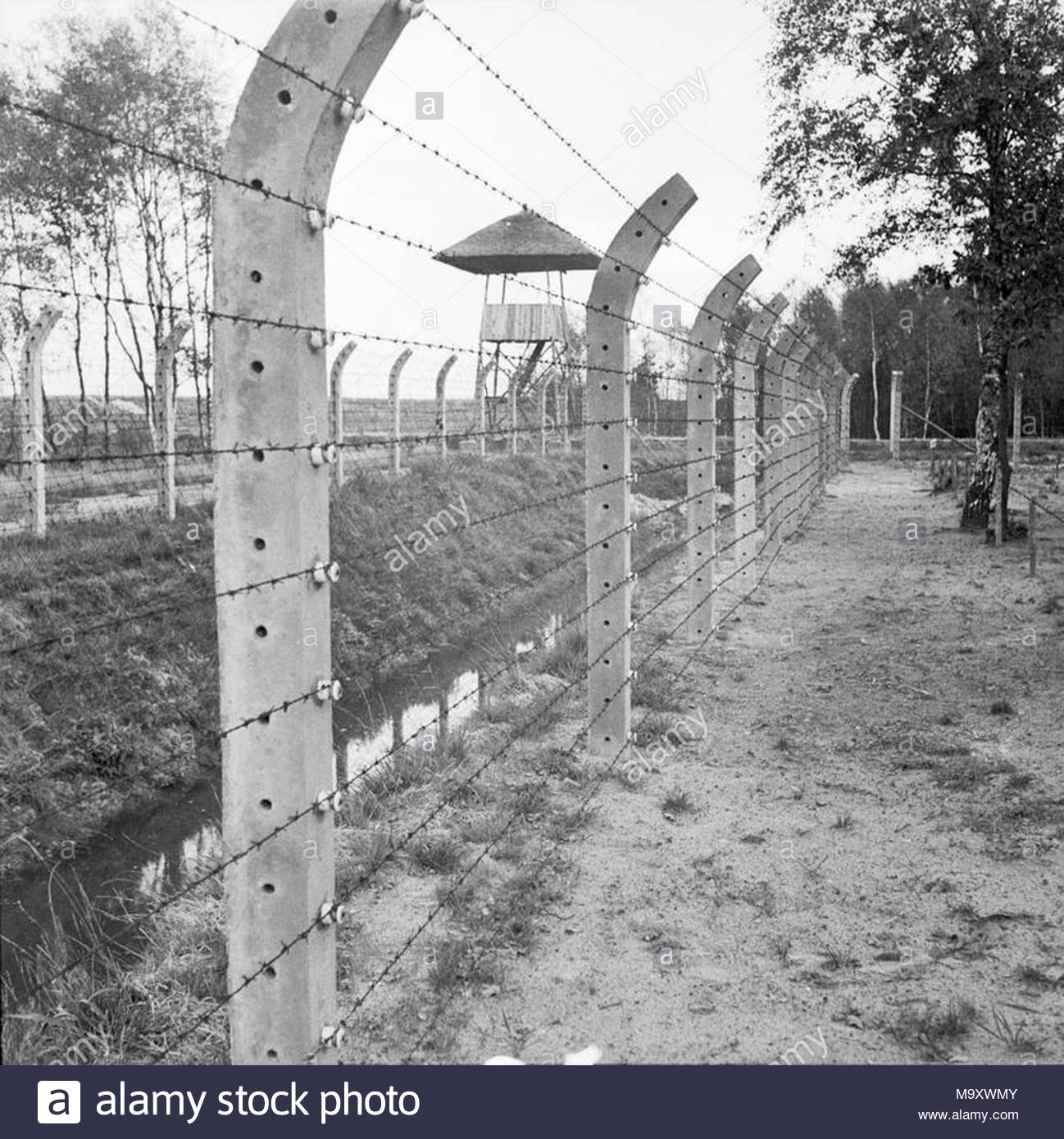 barbed wire fence concentration camp. Nazi Persecution Vught Concentration Camp: The Electrically Charged Barbed Wire Fence Around Camp Near Hertogenbosch In Holland. R