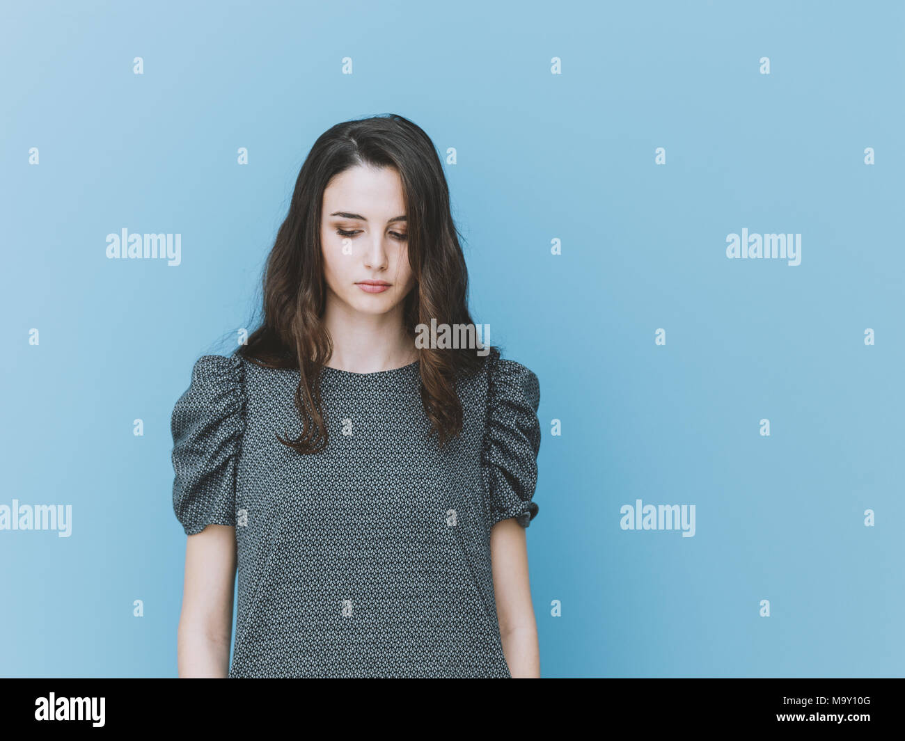 db417f1e3bd8 Elegant stylish girl looking down, she is sad and pensive Stock ...