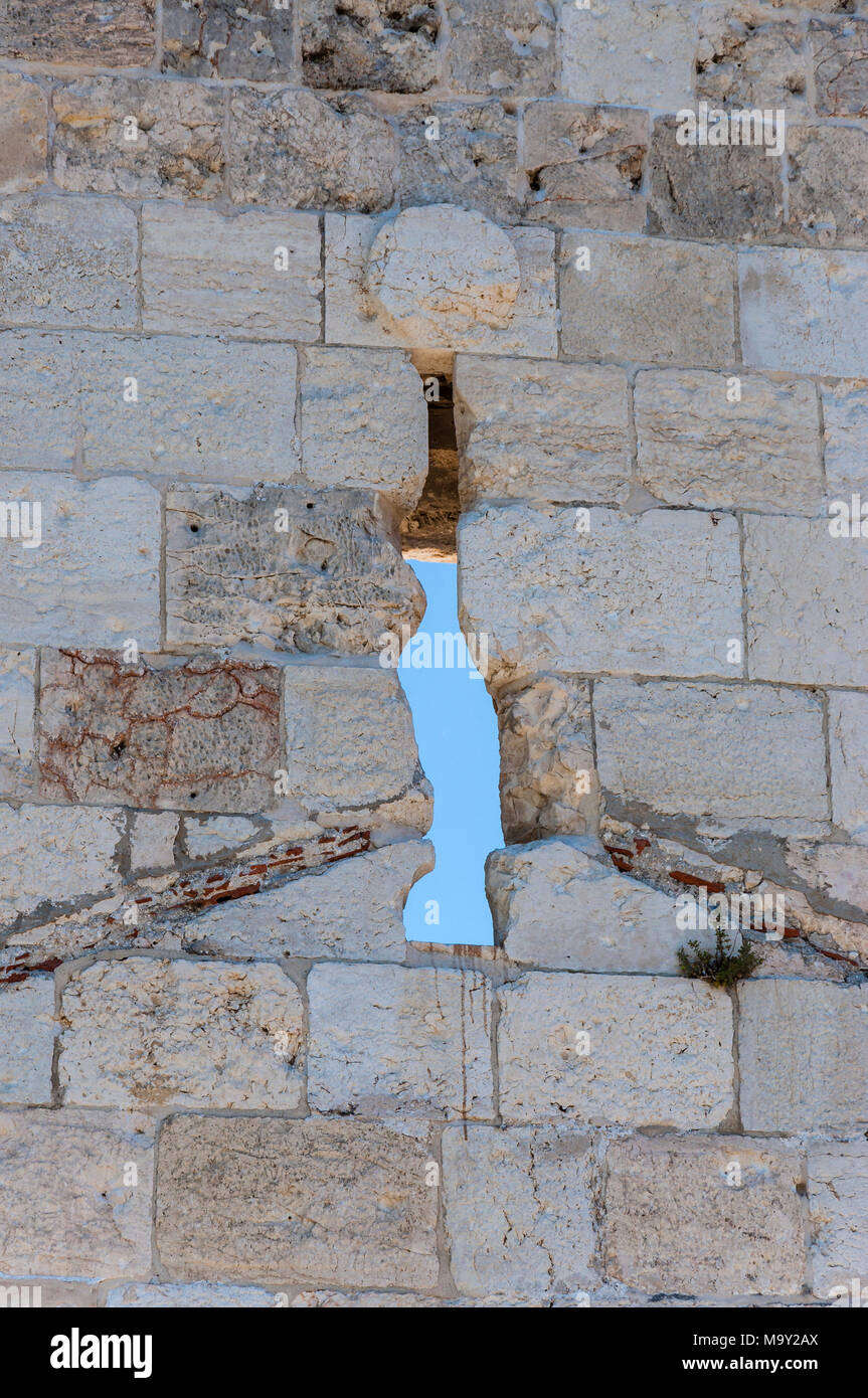Jerusalem stone design as a part of the fortress wall with loopholes - Stock Image